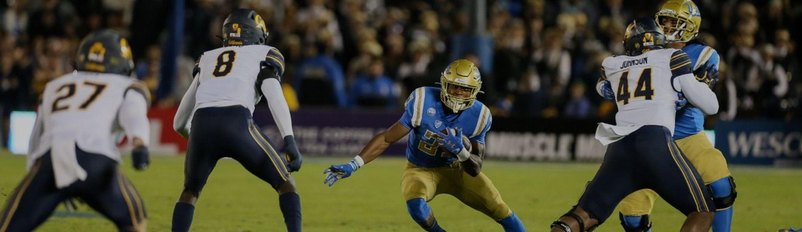UCLA runs the ball playing against the Cal Bears